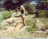 Liz and corgy standing in Rock garden