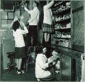 Pharmacy students oragnizing a laboratory, The University of Iowa, 1940s