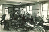 Engineering students working in basement of Physics Building, The University of Iowa, 1930s