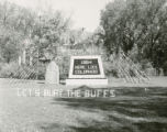 "Alumni Hall Homecoming lawn display, """"Let's bury the Buffs,"""" 1954"