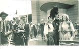 Scottish Highlander posing with women in ethnic dress, New York, New York, 1940