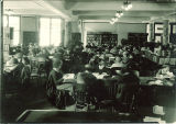 Students studying at tables in the library in Macbride Hall, the University of Iowa, January 1926
