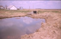 Water control structure near farmhouse