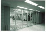 Glass doors looking into reference and information desk at Main Library, the University of Iowa, 1970