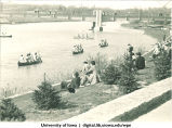 People watching students canoeing the Iowa River on Mother's Day, The University of Iowa, April 30, 1938