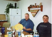 2005 - NRCS Soil Conservationist TJ Mathis and District Employee Dale Schmeiser  sit at a table after a lunch honoring T.J. Mathis who is leaving