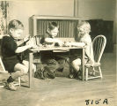 Children playing at table, The University of Iowa, January 12, 1938