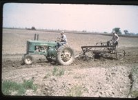 Tractor Pulling Farm Plow