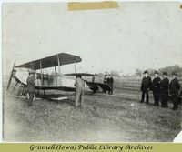 Billy Robinson's airplane and onlookers<br />