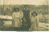Four sisters (?) posing outside, Edgewood (?), Iowa, 1910s