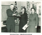 Jean Homewood of the US Army Europe Special Services Athletic Program receiving her nameplate, The University of Iowa, November 13, 1957