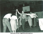 Couples square dancing, The University of Iowa, 1950s