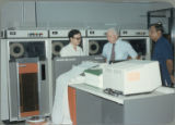 Earl O. Heady hearing about upgraded equipment at the Office of Agricultural Economics computer center in Bangkok, Thailand, 1983.