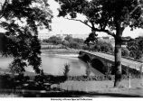 Bridge over Iowa River with Pentacrest in background, The University of Iowa, between 1924 and 1930