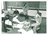 Demonstrating a tape recorder in high school classroom, The University of Iowa, 1950s