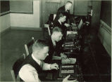 Physics students working with mechanical calculators, The University of Iowa, 1930s