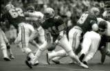 ISU quarterback tossing the ball during the Homecoming Game, 1985