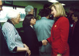 Louise Noun in receiving line to shake hands with Hillary Rodham Clinton, Des Moines Airport, Des Moines, Iowa, 1993