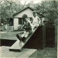 Children playing on wood platforms and slides, The University of Iowa, May 28, 1941