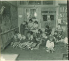 School children weaving in class, The University of Iowa elementary school, 1920s