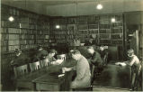 Students studying in a small library, The University of Iowa, 1920s