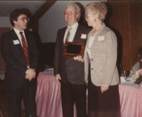 Ben Kern Giving Award to Mr. and Mrs. Paul Irving.