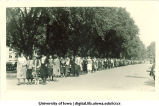 Procession of women walking south on Clinton St., The University of Iowa, 1920s