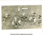 Notre Dame pass play against Iowa, South Bend, Ind., November 16, 1940