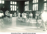 Social time before class in gymnasium, The University of Iowa, 1950s