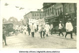 Men in white smocks marching in parade, The University of Iowa, 1910s