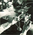 Using test tubes and a bunson burner for an experiment, The University of Iowa, 1930s