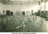 Students stretching in a gymnasium, The University of Iowa, 1930s