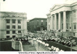 Crowd listening to a band performance on the steps of the Old Capitol, The University of Iowa, 1930s