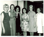 Group of women posing with Anna Chennault, 1973