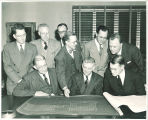 Officials viewing architectural plans of new Midwest Inter-Library Center in Chicago, The University of Iowa, 1951