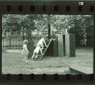Children climbing on wood platforms and slides, The University of Iowa, May 10, 1941