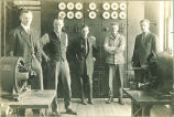 Engineering students in basement of Physics Building, The University of Iowa, 1920s