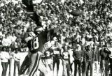 John Quinn, Quarterback, throws the football at  Homecoming, 1980