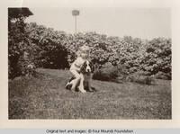 Vidie and Bobby by lilac bush