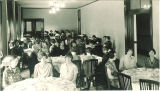 Students in a Currier Hall dorm dining room, The University of Iowa, May 1927
