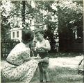 Woman comforts small boy outside, The University of Iowa, May 28, 1941