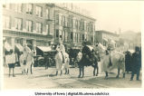 Costumed men on horses in parade, The University of Iowa, 1910s