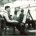 Art student gazing at painting, The University of Iowa, 1940s