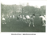 Ready to start field hockey game with Pentacrest in background, The University of Iowa, 1940s