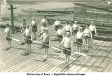 Land drill demonstrating rest paddles, The University of Iowa, 1930s