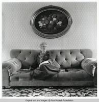 Elizabeth sitting on sofa
