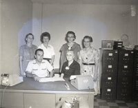 One Man and Five Women at Desk