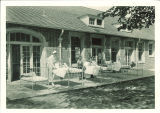 Children sunning in beds on the veranda at the Children's Hospital, The University of Iowa, 1920