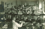 Pharmacy students working in assigned places in pharmacy laboratory, The University of Iowa, 1910s