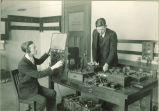 Students operating electrical apparatus in Physics laboratory, The University of Iowa, 1920s